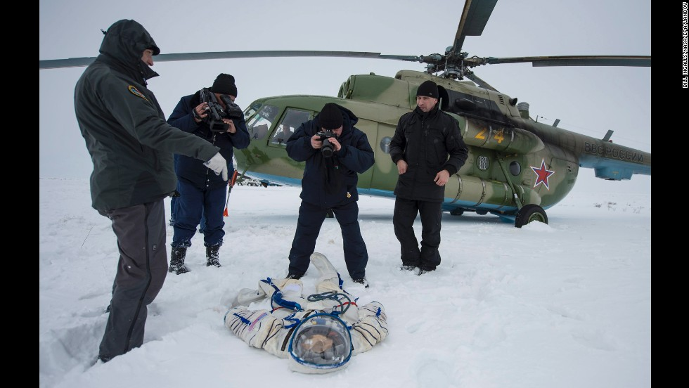 "A photographer documents the suit worn by American astronaut Mike Hopkins after <a href=""http://www.cnn.com/2014/03/11/tech/innovation/russia-us-space-program-ukraine/index.html"">a Soyuz TMA-10 capsule landed</a> near Zhezkazgan, Kazakhstan, on Tuesday, March 11. The capsule brought Hopkins and two cosmonauts home to Earth after they spent five months aboard the International Space Station."