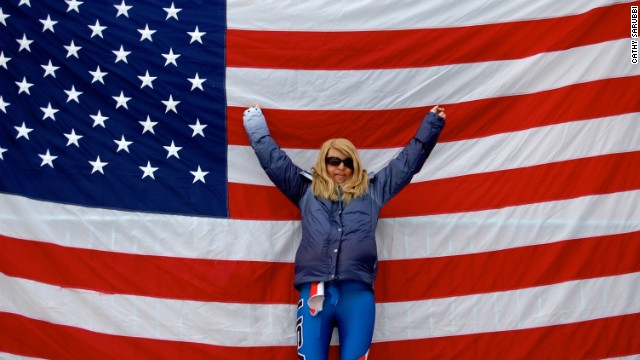Caitlin Sarubbi, a disabled U.S. skier, stands before a flag at the 2010 Winter Paralympic Games in Vancouver.