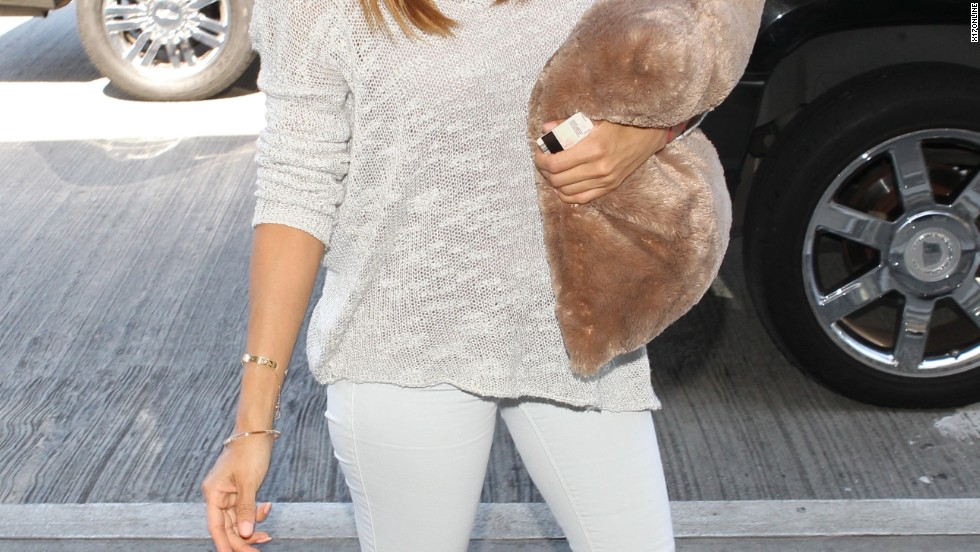 Eva Longoria bangs on to another flight out of Los Angeles on March 12.