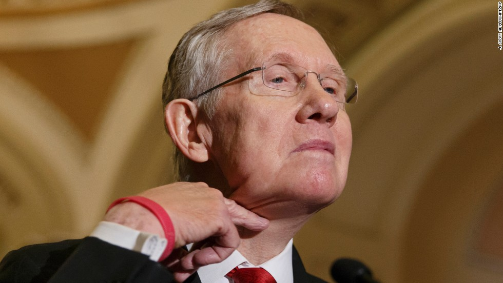 "Senate Majority Leader Harry Reid makes a cutting gesture across his neck Tuesday, March 11, referencing California Rep. Darrell Issa, who <a href=""http://politicalticker.blogs.cnn.com/2014/03/06/issa-tries-to-clear-the-air-with-rep-cummings-2/ "">caused an uproar last week</a> when he cut the microphone of his Democratic counterpart on the Oversight and Government Reform Committee."