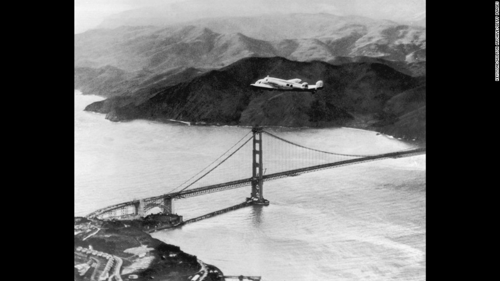 The Lockheed Electra, piloted by Amelia Earhart and Fred Noonan, flies over the Golden Gate Bridge at the start of a round-the-world flight on March 17, 1937. The two vanished during a similar flight in 1937.