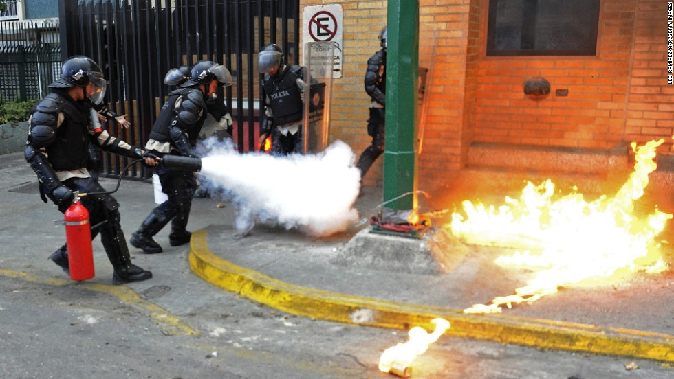 Police officers put out a Molotov cocktail on March 13.