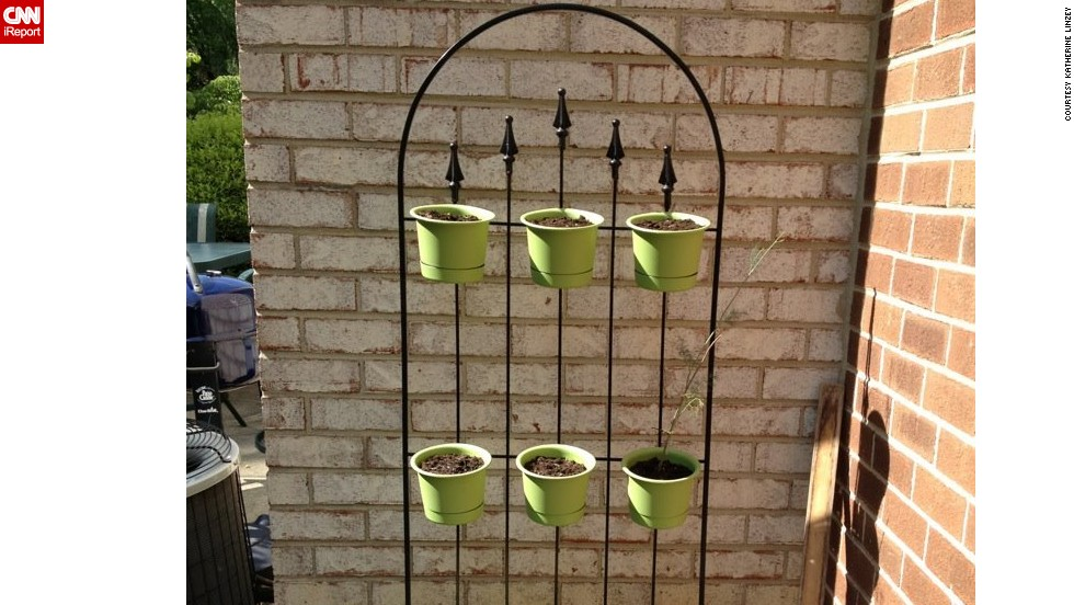 "A standing herb garden, inspired by several similar photos on Pinterest and assembled by Linzey's husband ""so that we can all enjoy some outside time. Anabelle's room has a sliding door that opens right into the garden, so it is easy for her to sit outside while we plant and tend."""
