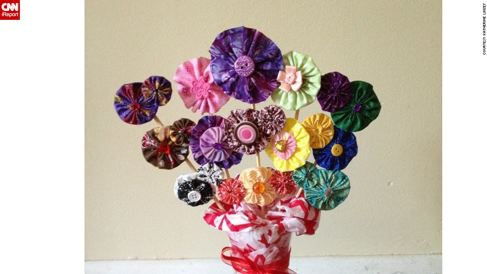 "A fabric-flower hair clip display made as a raffle gift for a fundraiser for <a href=""http://www.anabelleswish.org"" target=""_blank"">Anabelle's Wish</a>, a charitable organization in Anabelle's name to assist families who have children with rare neurological disorders."