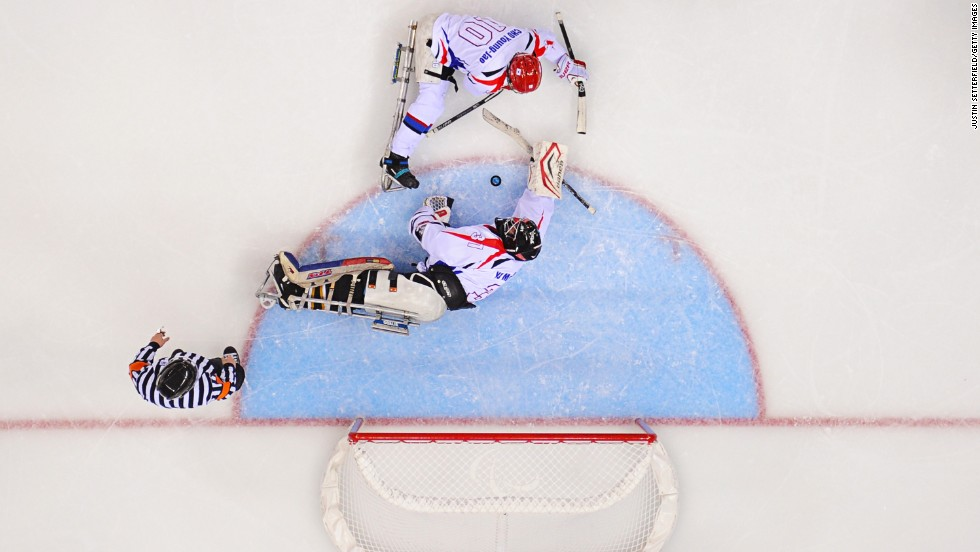 Goalie Man-Gyun Yu and defender Young-Jae Cho of South Korea stop Sweden from scoring in a hockey game March 14.