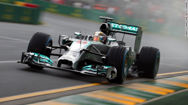 Mercedes driver Lewis Hamilton followed up his hot practice form by qualifying fastest in the wet conditions at Albert Park.