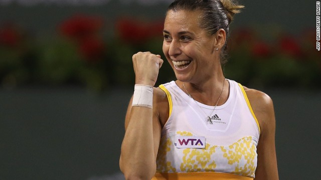 Italian tennis player Flavia Pennetta celebrates her victory over China's world No. 2 Li Na at Indian Wells Tennis Garden.