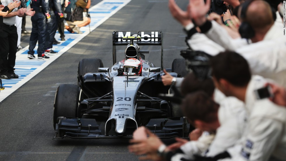 Kevin Magnussen receives the plaudits of his McLaren team after a stunning drive to finish on the podium on his F1 debut.