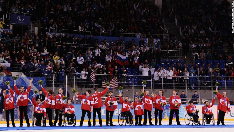 Canadian players react during the medal ceremony after the ice sledge hockey gold medal game between the Russian Federation and the United States on Saturday, March 15. The United States won, 1-0.