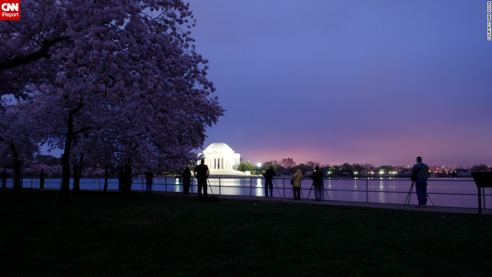"Travelers enjoy the sight of cherry blossoms so much that crowds start gathering in the park as early as sunrise, which is when <a href=""http://ireport.cnn.com/docs/DOC-763864"">Ian Dixon</a> captured this photograph in March 2012. ""Even at 7 a.m. it was getting tough to find good spots to shoot from due to all the photographers around,"" he said."
