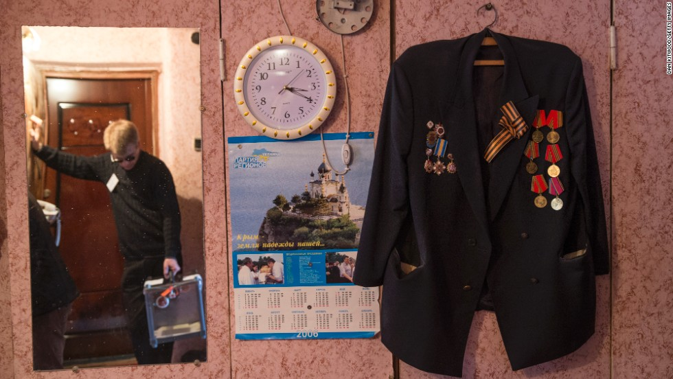 Referendum staff wait to collect the vote of WWII veteran Grinevich Oleksander in Bakhchysaray, Ukraine, on March 16.