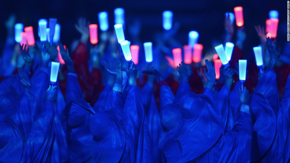 In another shot of the glow sticks, participants are basked in color.