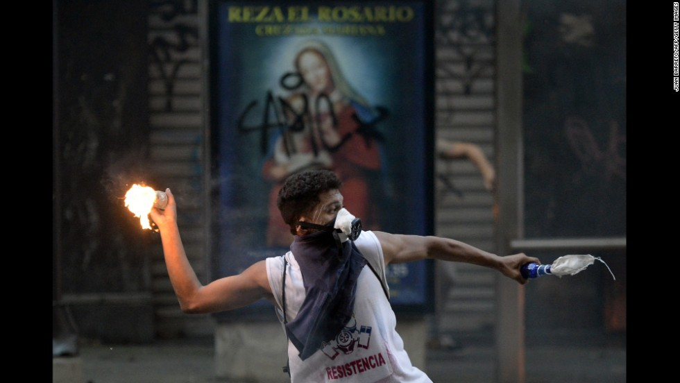 A demonstrator clashes with government forces during a protest in Caracas on Saturday, March 15.