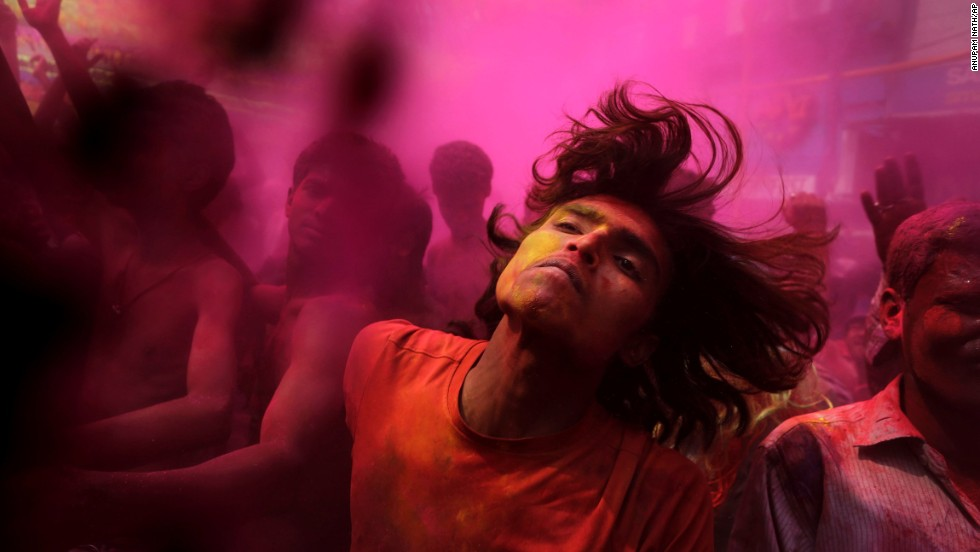 Men and women dance during celebrations in Gauhati, India, on March 17.