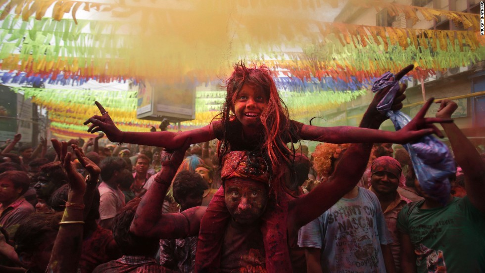 A girl sits on her father's shoulders during celebrations in Gauhati on March 17.