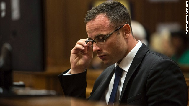 Oscar Pistorius, sits in the dock on March 17, 2014. during his trial for the murder of his girlfriend Reeva Steenkamp.