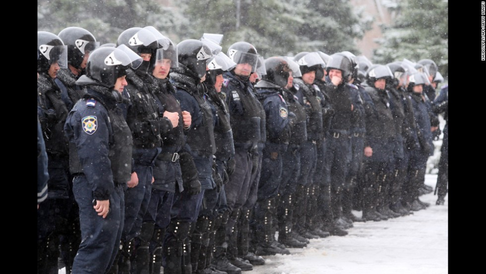Policemen stand guard outside the regional state administration building in Donetsk, Ukraine, during a rally by pro-Russia activists March 17.
