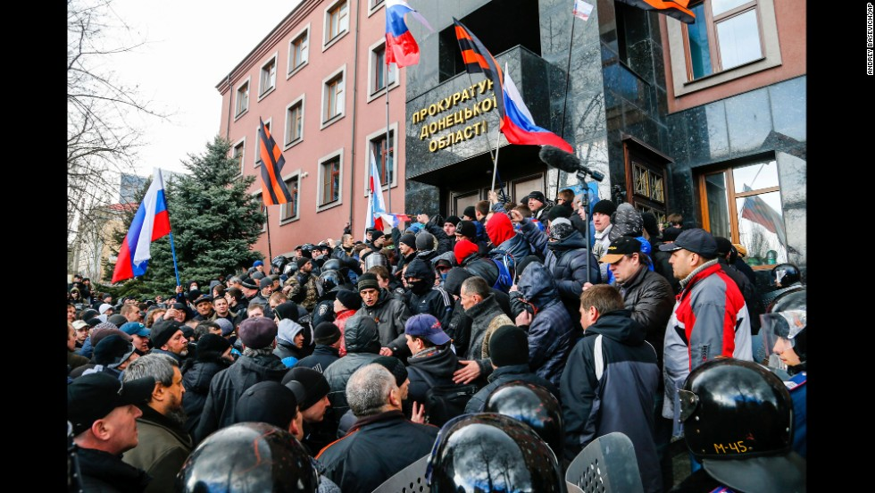 Pro-Russia demonstrators storm the prosecutor general's office during a rally in Donetsk on March 16.