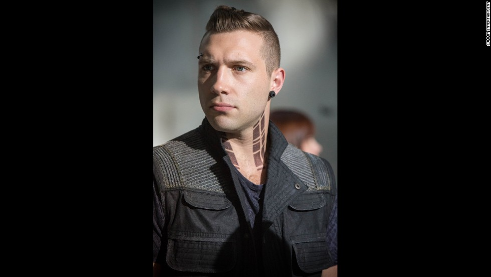 Along with Four, Eric (Jai Courtney) coaches newcomers in the Dauntless way of life. A leader in Dauntless, Eric is a cruel coach who believes in showing bravery through competition and force.