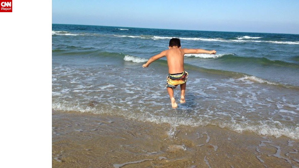 """<a href=""""http://ireport.cnn.com/docs/DOC-1096761 """">Gracen Stewart</a> says 5 or 6 years old is when kids start to notice where they are """"and can actually enjoy it."""" Her son, Julian, was 6 when she took him to South Padre Island, Texas. """"The greatest part of this trip was seeing how happy he was,"""" she said. """"He was able to jump around in the ocean and he loved it. We would walk out and as I held his hand, we'd both jump and let the waves knock us over."""""""