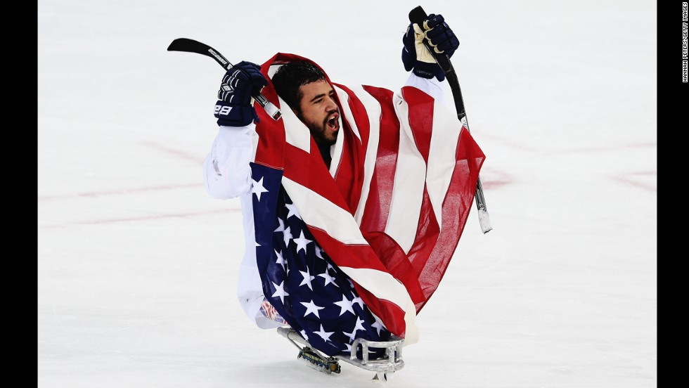 Nikko Landeros celebrates after the U.S. ice sledge hockey team won the gold medal game against Russia on Saturday, March 15, at the Paralympic Games.