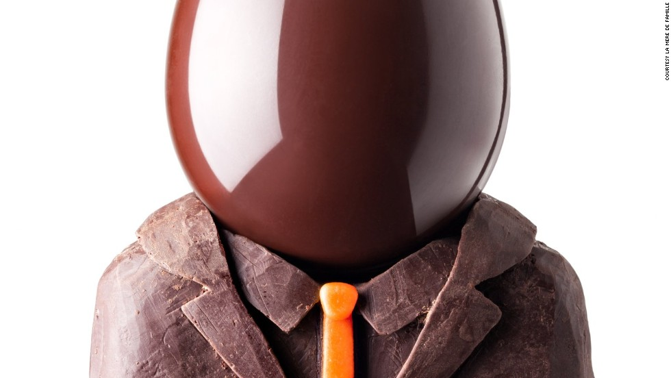"At <a href=""http://www.lameredefamille.com/"" target=""_blank"">La Mere de Famille</a>, renowned chocolatier Julien Merceron dressed his egg in an elegant milk and dark chocolate suits. The ""Tete d'Oeuf"" comes with a colorful sheet of facial features to cut out and personalize the Easter treat."