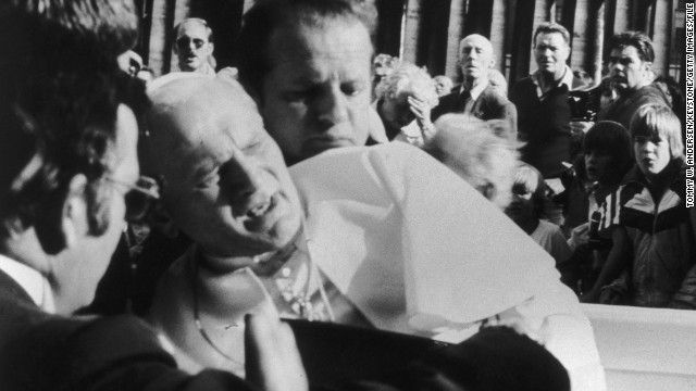 Pope John Paul II reacts after being shot by would-be assassin Mehmet Ali Agca in St Peter's Square, 13th May 1981.