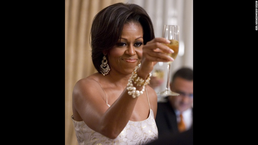 Scott's elegant designs are popular among celebrities and politicians. In this image from March 2011, first lady Michelle Obama wears a L'Wren Scott dress during an official dinner at the National Palace in El Salvador.