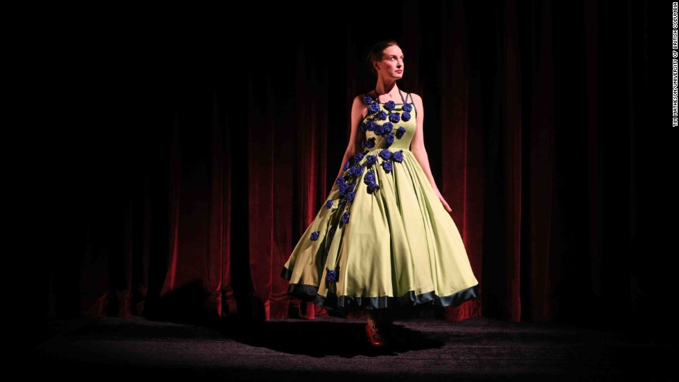 Bronwyn Malloy, a University of British Columbia alumna and master's student at McGill University, models a green silk charmeuse dress inspired by astrocytes. On the microscopic slide, the blue circles are cells. On the dress, they appear as beautiful rosettes, according to Firkins.