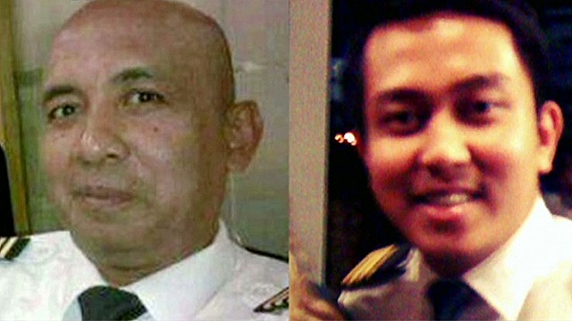 Flight 370 pilots' homes searched