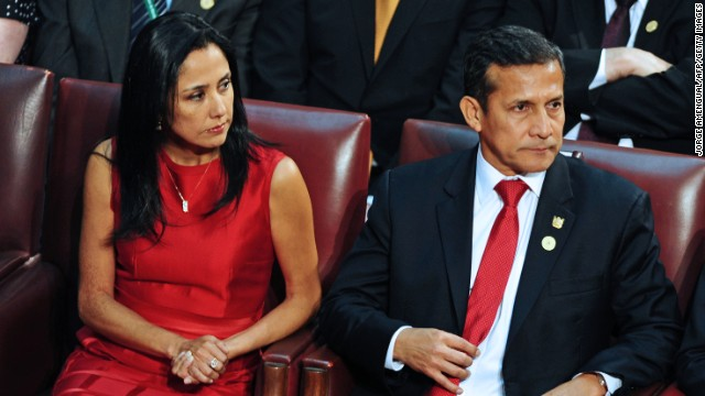 Peru's President Ollanta Humala (R) and his wife Nadine Heredia (L) attend the inauguration ceremony of Chilean President Michelle Bachelet at the Congress in Valparaiso, Chile, on March 11, 2014. Socialist Bachelet took the oath of office as president of Chile Tuesday, returning to power after four years with a reform agenda to reduce social disparities in this prosperous South American country. AFP PHOTO/JORGE AMENGUAL (Photo credit should read JORGE AMENGUAL/AFP/Getty Images)