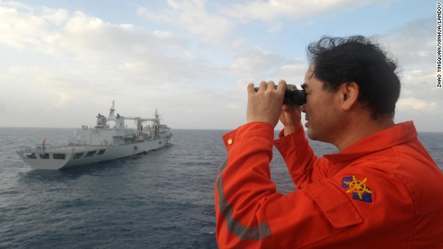 """Image #: 28152349    (140318) -- ABOARD NANHAIJIU 101, March 18, 2014 (Xinhua) -- Vice commander of the Chinese rescue vessel """"Nanhaijiu 101"""" Zhang Jianxin watches as the ship approaching Qiandaohu comprehensive supply ship, as both of them head toward Singapore to join in the search for missing Malaysia Airlines flight MH370, March 18, 2014. At 8:00 a.m. on Tuesday, China's Ministry of Transportation ordered all Chinese vessels in the Gulf of Thailand to leave for searches in the waters southeast of the Bay of Bengal and near the Sunda Strait.   (Xinhua/Zhao Yingquan/XINHUA/LANDOV"""
