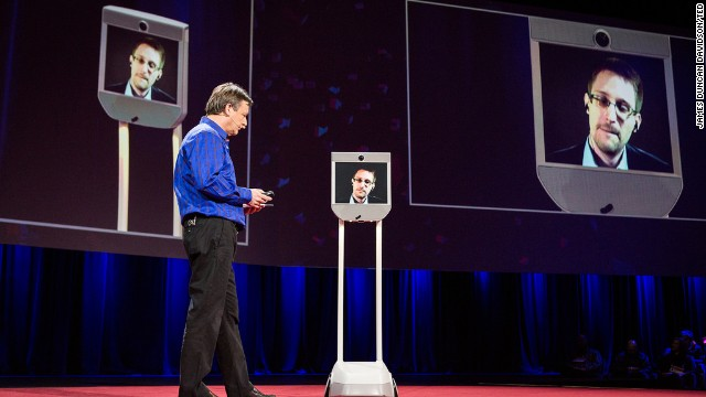 Edward Snowden, on screen, talks from Russia with TED's Chris Anderson at the TED2014 conference.