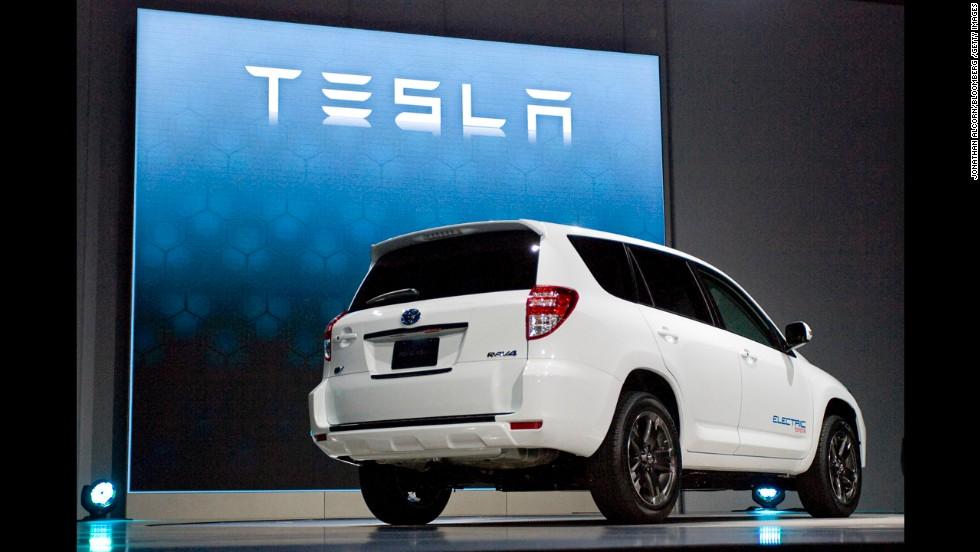 Tesla RAV4 EV is displayed at an auto show.