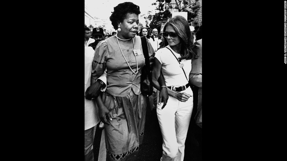 "Steinem walks with writer Maya Angelou on their way to the March on Washington on August 27, 1983. The event commemorated the 20th anniversary of Martin Luther King Jr.'s ""I Have a Dream"" speech."