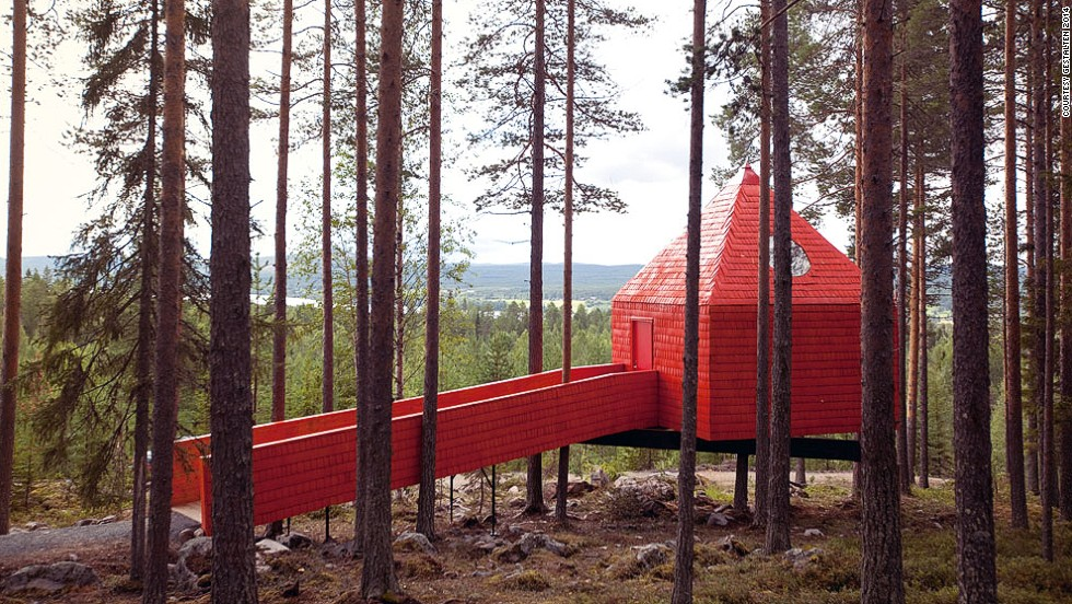 "<em>Blue Cone (Treehotel), Sweden</em><br /><br />Boldly standing out among the trees, this bright crimson hotel room in the Swedish countryside is almost child-like in its outer design. The beautifully simplified structure almost resembles a Lego block, and the guiding idea behind the <a href=""http://www.sandellsandberg.se/news"" target=""_blank"">Sandell Sandberg</a> studio's design was to make it accessible.  <br /><br />Unlike most other forest cottages, Blue Cone is not meant to blend in with the surroundings, but act as a prominent landmark that attracts visitors from a far."