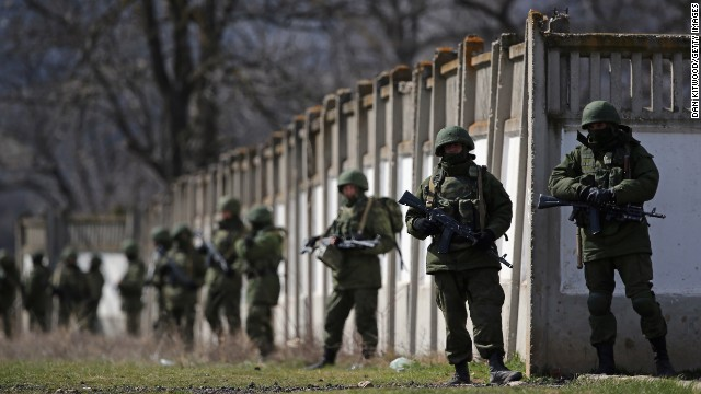 Russian military personnel surround a Ukrainian military base in Perevalnoe, Ukraine, on March 19.