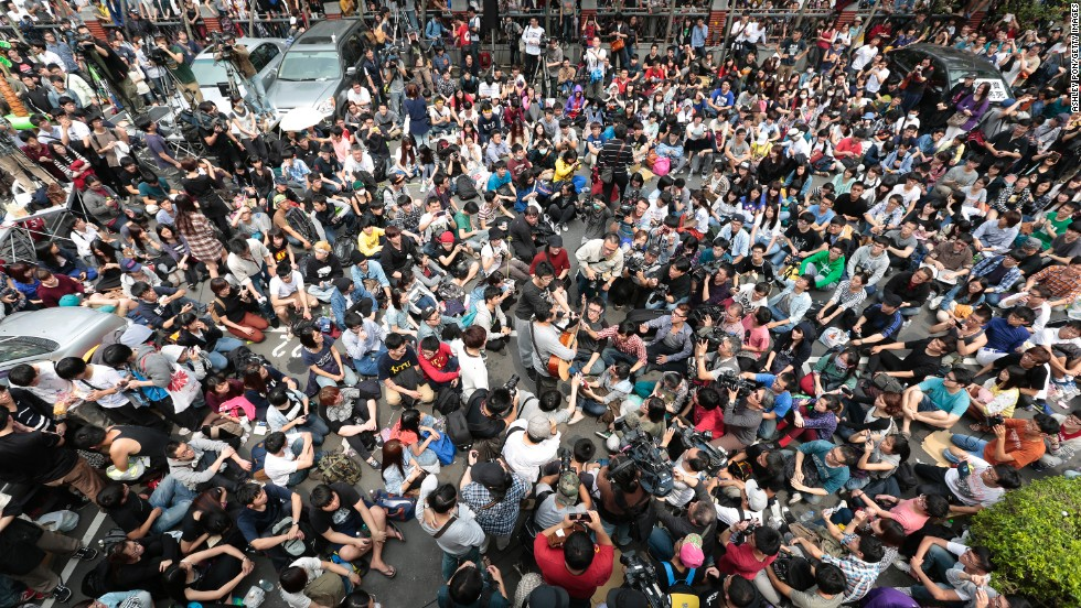 Students occupy the plaza outside the Legislature on March 19.