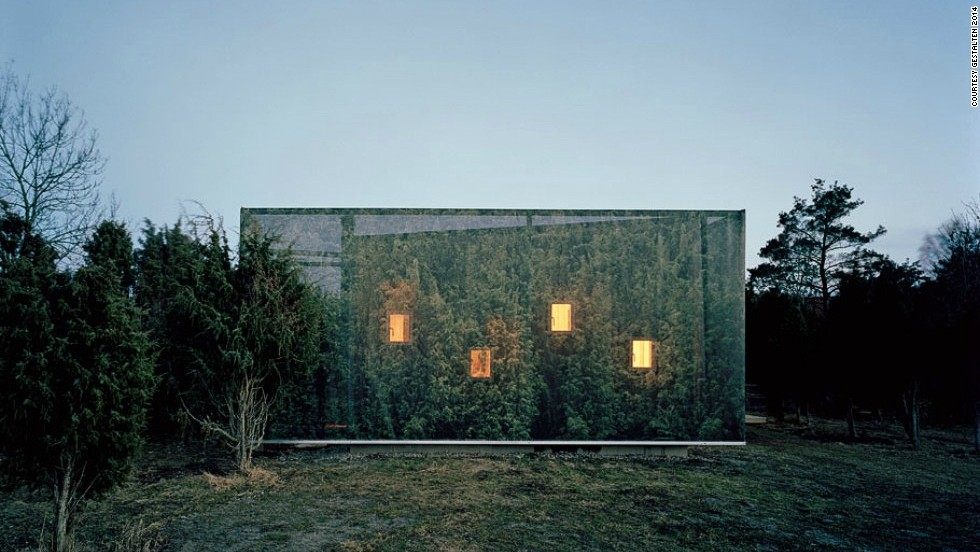 "<em>Juniper House, Sweden</em><br /><br />This beautifully camouflaged house was a project of personal significance for architect<a href=""http://www.murman.se/#!/juniper/juniper.htm"" target=""_blank""> Hans Murman</a>, who designed it as a weekend getaway for his family. Set within a grove of tall junipers, the exterior is wrapped in a cloth photographic reproduction of the surrounding trees, giving it a sense of calm and oneness with the nature. Through the low-placed windows, inhabitants can sneak a peak at wild rabbits scurrying along the grass in the morning."