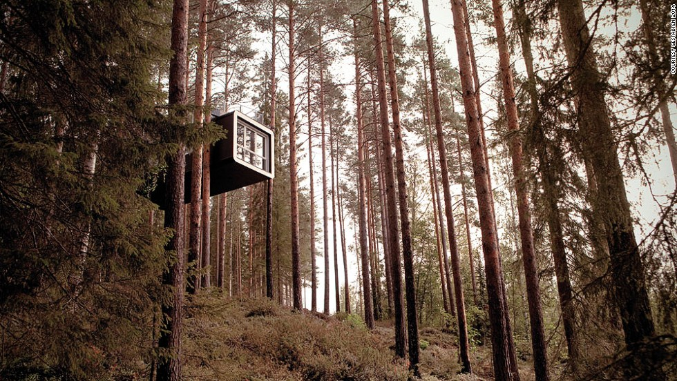 "<em>The Cabin (Treehotel), Sweden</em><br /><br />Hovering high up above a river valley, this gravity-defying tree-house looks almost like a futuristic ship lodged between the forest's ancient trees. It's the brainchild of the architectural sibling duo <a href=""http://www.cyren.se/english.asp"" target=""_blank"">Mårten and Gustav Cyrén</a> who got the idea while on a fishing trip in the Russian forest: ""The weather was poor and the fishing equally bad, so we huddled around the campfire and started talking about a remote guesthouse in Sweden that we knew of. Something special was needed to put the spotlight on this place, with its nature and its dramatic change of seasons."" <br /><br />The cabin is accessed is through a bridge that cuts through the forest floor, and inside the bed is centrally located so that the stunning panorama is the first thing you see when you wake up."