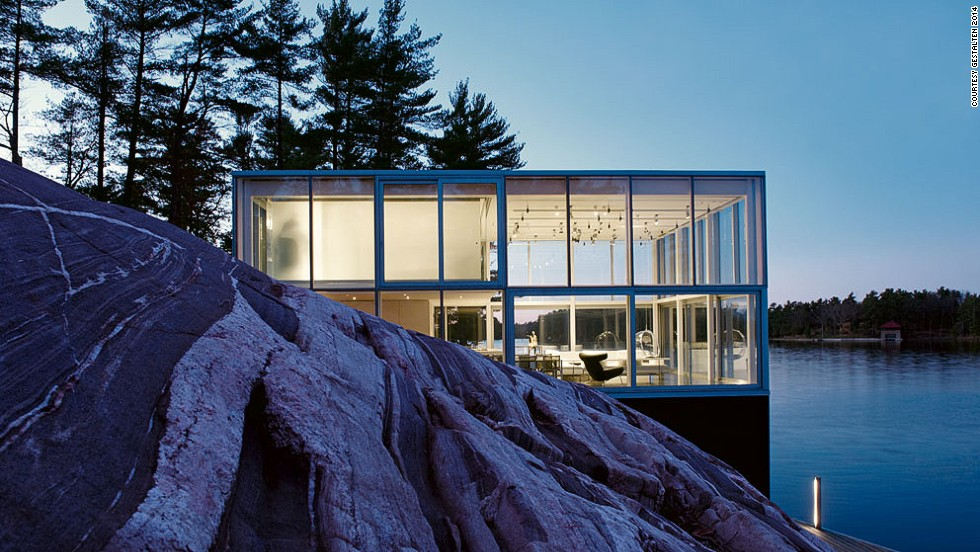 "<em>With Held, Canad</em>a<br /><br />Perched on the edge of a lake, this photographer's studio is a glass marvel open to the landscape on all sides. One of the priorities for the architects, Toronto-based <a href=""http://www.gh3.ca/"" target=""_blank"">studio GH3</a>, was to create a space bathed in light, a crucial demand for the client's professional needs. When the night falls, the house lights up as a lantern on the edge of the water."