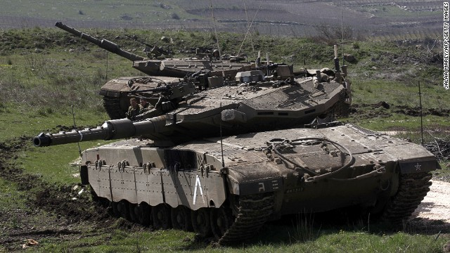 An Israeli tank stationed near Majdal Shams on the border with Syria, on March 19,2014 in Israeli-annexed Golan Heights.