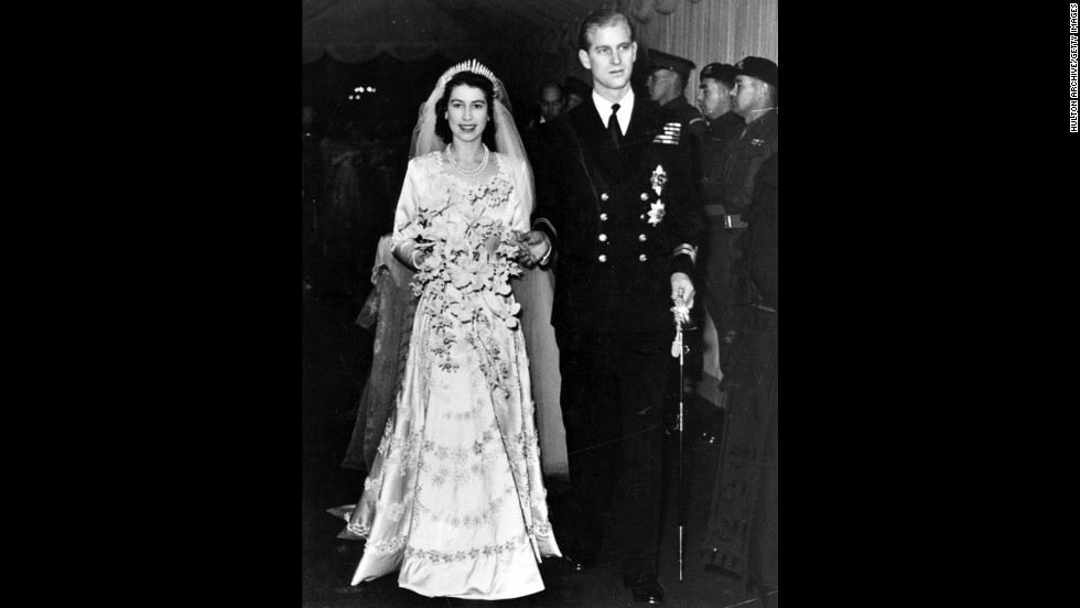 Queen Elizabeth II, as Princess Elizabeth, and her husband the Duke of Edinburgh, styled Prince Philip in 1947, on their wedding day. She became queen on her father King George VI's death in 1952.
