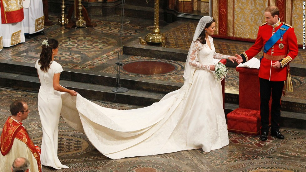Britain's Prince William and his wife Kate, Duchess of Cambridge, accompanied by her maid of honor Pippa Middleton leave after the wedding service in Westminster Abbey in central London on April 29, 2011.