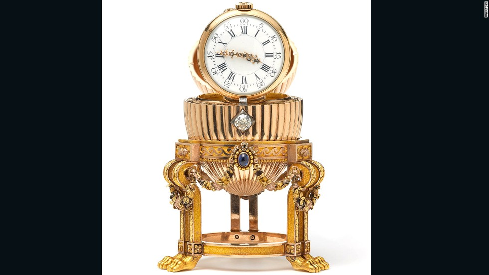 The diamond mechanism opens the egg to reveal a Vacheron Constantin watch inside. The gold watch with diamond hands is hinged to stand upright.