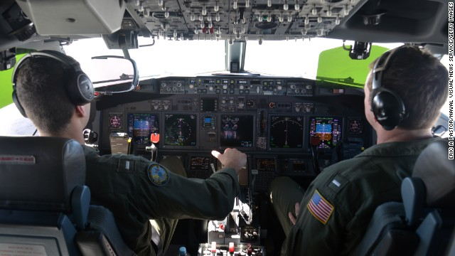 In this undated photo provided by the Navy Visual News Service, Lt. j.g. Kyle Atakturk, left, and Lt. j.g. Nicholas Horton, naval aviators assigned to Patrol Squadron (VP) 16, pilot a P-8A Poseidon during a mission to assist in search and rescue operations for Malaysia Airlines flight MH370 on March 19, 2014 over the Indian Ocean.