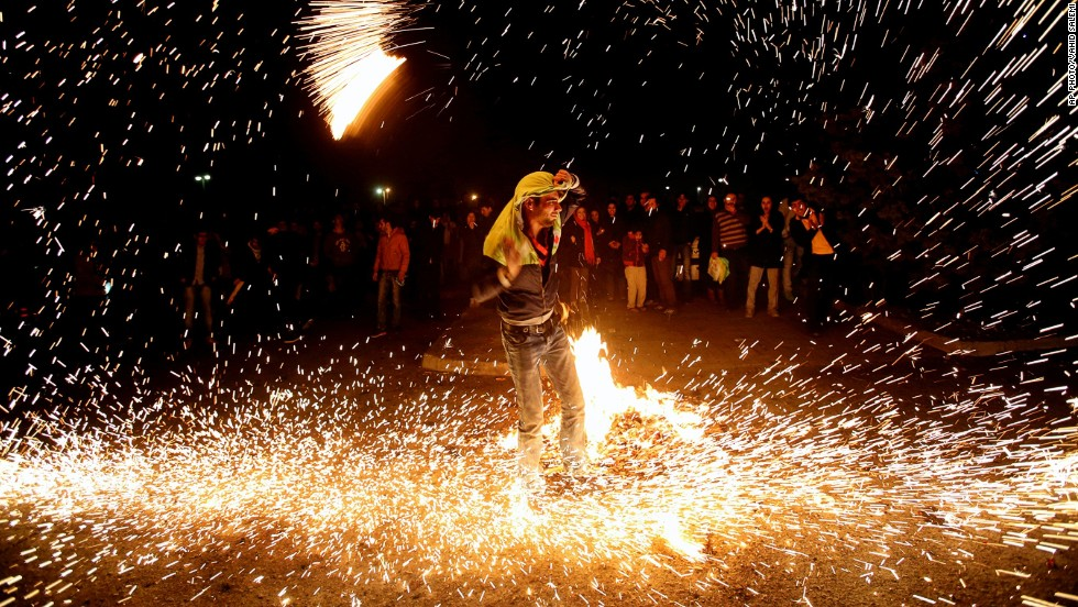 "MARCH 20 - TEHRAN, IRAN: An Iranian man lights fireworks during a celebration, known as ""Chaharshanbe Soori,"" held on  the eve of the last Wednesday before spring, in Pardisan Park. The first day of spring is known as Nowruz -- the Persian new year."