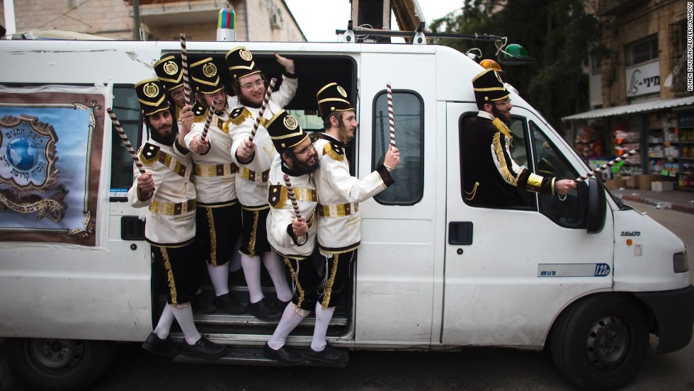 Ultra-Orthodox Jewish men wear costumes as they celebrate the Purim holiday Monday, March 17, in Jerusalem.