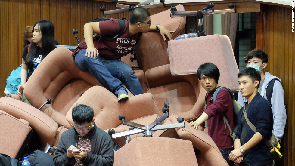 "Protesters use chairs to block the entrance of Taiwan's Legislature on Wednesday, March 19, after occupying the building in Taipei, Taiwan. The protesters, mostly university students, are <a href=""http://www.cnn.com/2014/03/19/asia/gallery/taiwan-protests/index.html"">against the ruling party's push</a> for a trade pact with China."