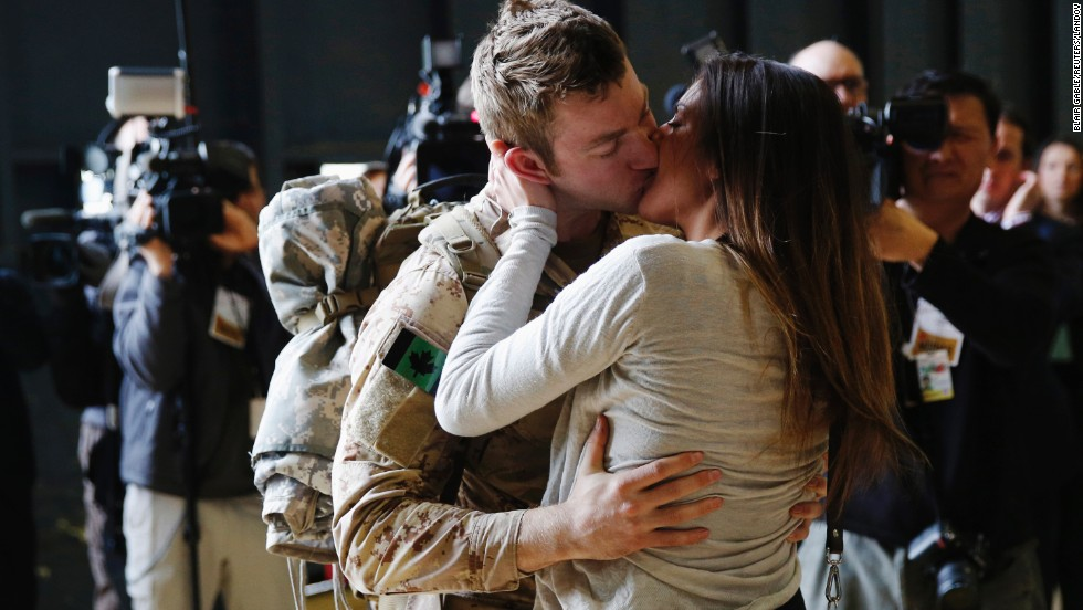Master Cpl. Anthony Alliot of the Canadian Army kisses Sarah Tooth after arriving home from Afghanistan on Tuesday, March 18. Canada's 12-year mission in Afghanistan is now over, its military said.